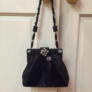 Black cocktail handbag with tassel