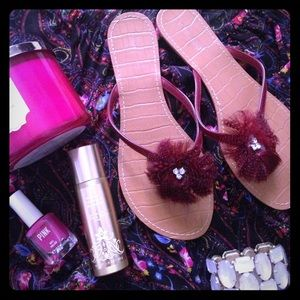 Red feather and rhinestone sandals