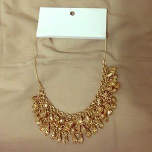 Golden tear statement necklace