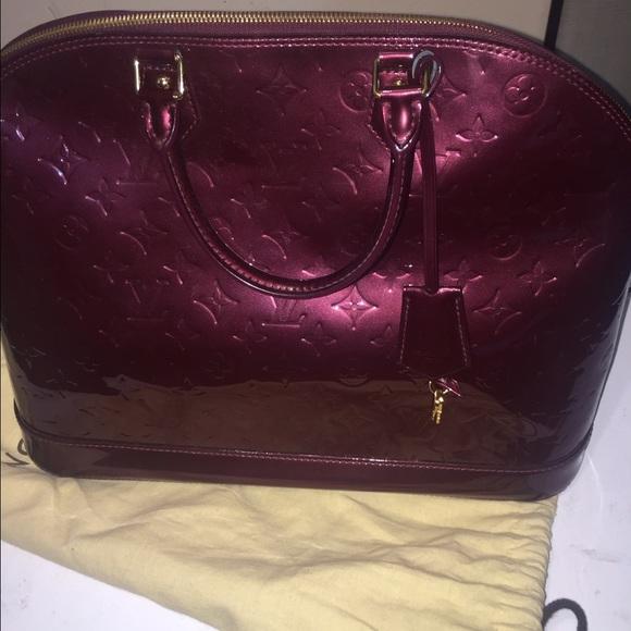dd305c4486df Louis Vuitton Handbags - Louis Vuitton Alma GM Vernis color  Rouge Favista