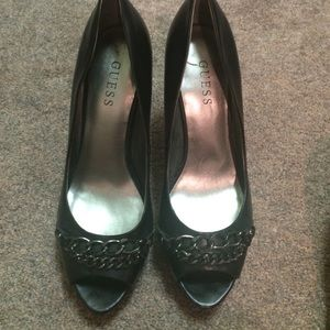 Guess open toe heels with pretty metal accents.