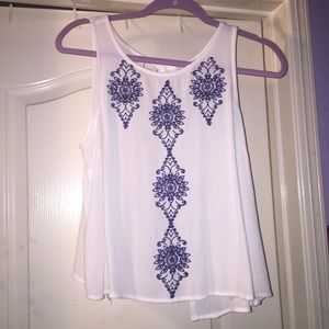 white embroidered open back top