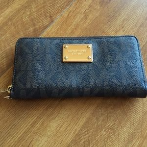 Brown Michael Kors jet set logo zip around wallet
