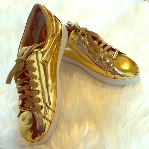 8bdcb7abff8bc Michael Kors gold metallic sneakers. M 578e8a6b4127d0b5b100bdd2