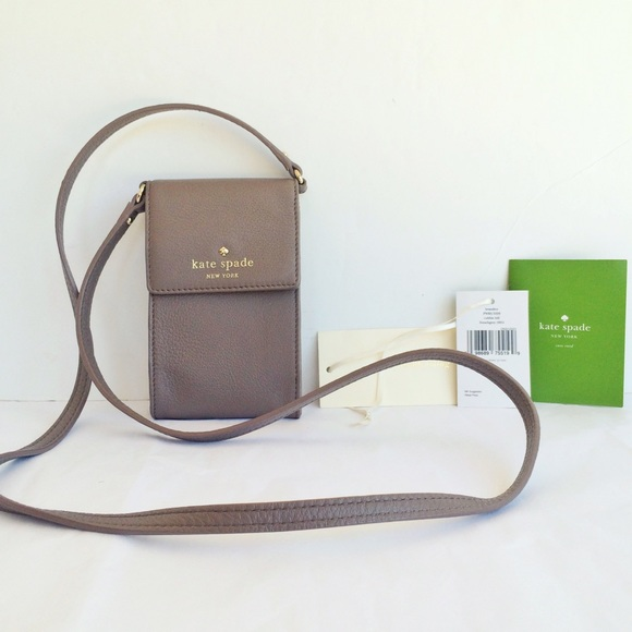 sports shoes 931a0 69e68 Brand new Kate Spade cell phone and card holder! NWT