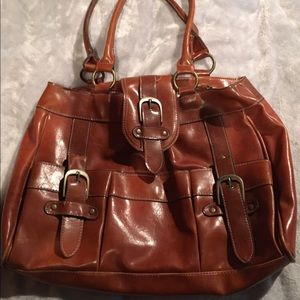 Large Brown tote with exterior pockets.