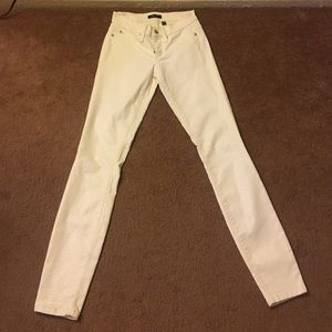 Hard to find white snake skin Bebe jeans
