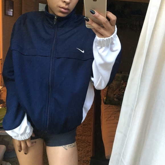 Small navy and white nike jacket. M 579119c7c2845690ed008d32 a47a89f2b