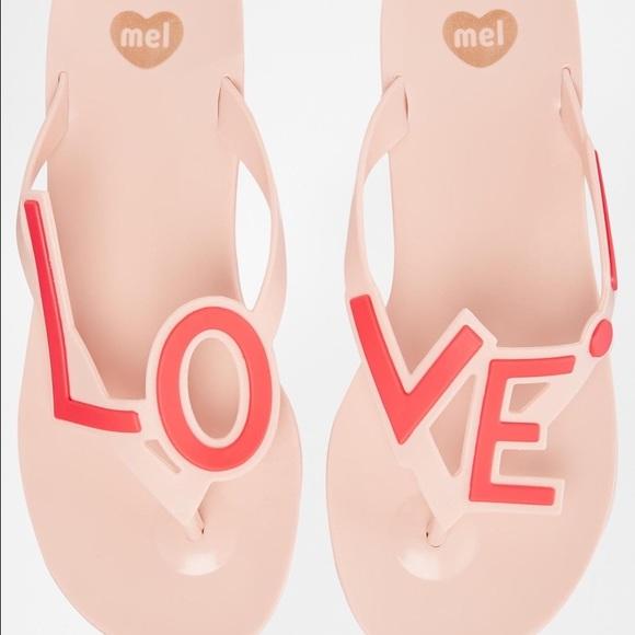 dc6a5ba06 Mel dreamed by Melissa Love City pink flip flops. M 57916d74291a358f0c00671e