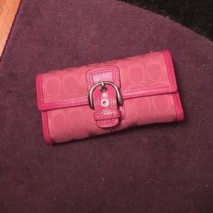 Pink signature COACH wallet