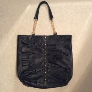 Black and gold ruffled & studded faux leather tote