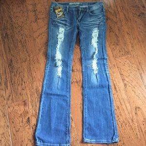 Spool 72 Denim - Distressed jeans.