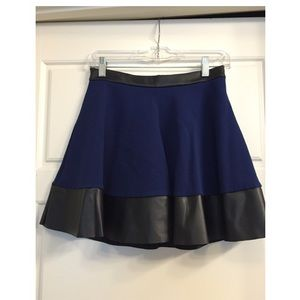 Topshop mini skirt with black leather trim
