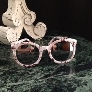 Karen Walker INSPIRED sunglasses.