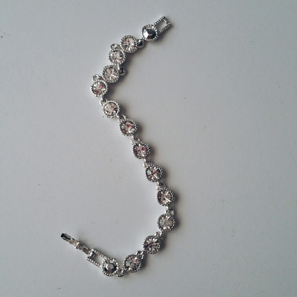 Avon Jewelry - Silvertone Rhinestone Tennis Bracelet