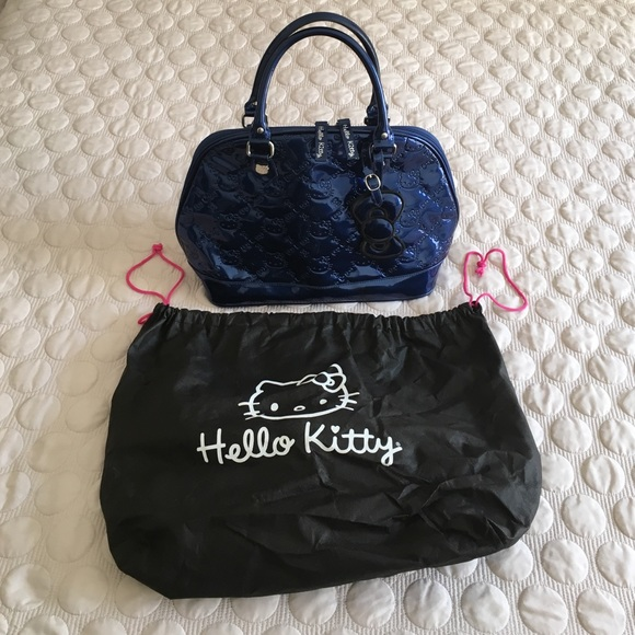 Hello Kitty Handbags - Rare blue hello kitty LOUNGEFLY purse d498d186fa0c8