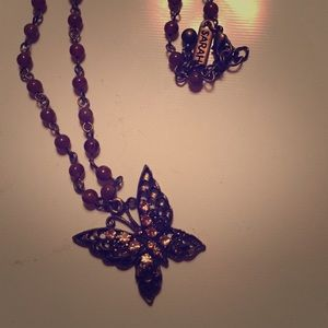 Butterfly pendant with beaded chain.