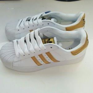 superstars gold stripes
