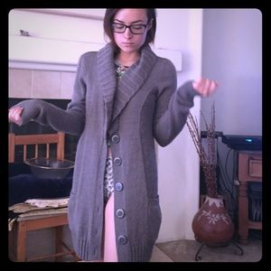 Grey, long, cardigan sweater with buttons.