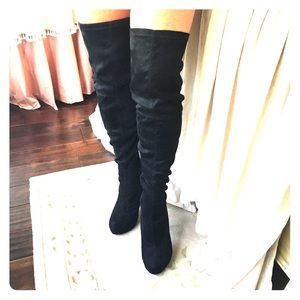 Black suede thigh high boots.  Worn once