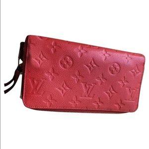 Orient monogram empriente leather secret wallet