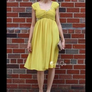 C'est Ca New York Dresses & Skirts - Empire waist yellow embellished dress