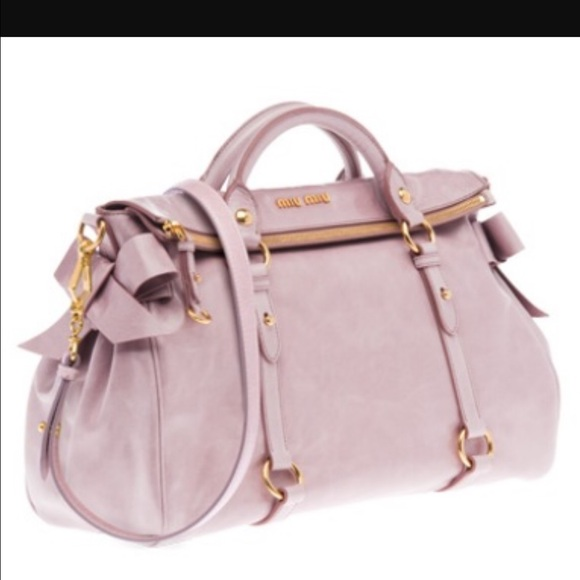 bf1c00c7b9f2 Miu miu bow satchel with shoulder strap. M 579bdd1e6d64bcbd4a05126b. Other  Bags you may like