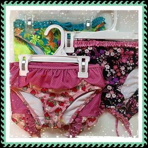 Set of three toddler bathing suits.