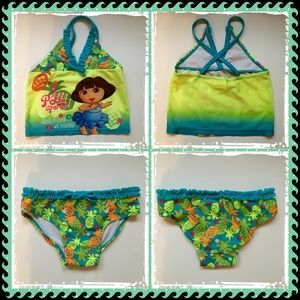 Swim - Set of three toddler bathing suits.