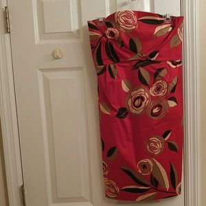Red strapless dress with flowers.