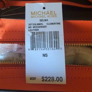 344bc7c15d9e02 Michael Kors Bags - Michael Kors Selma Medium Crossbody Bag Clementine
