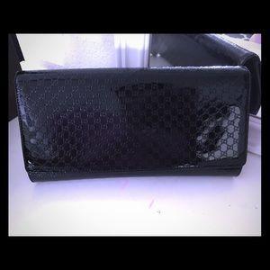 Authentic Gucci black patent leather clutch