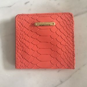 GiGi New York fold over wallet embossed Python