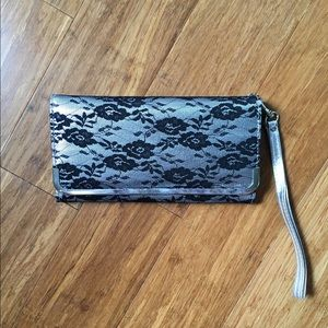 Charming Charlie silver and black lace clutch