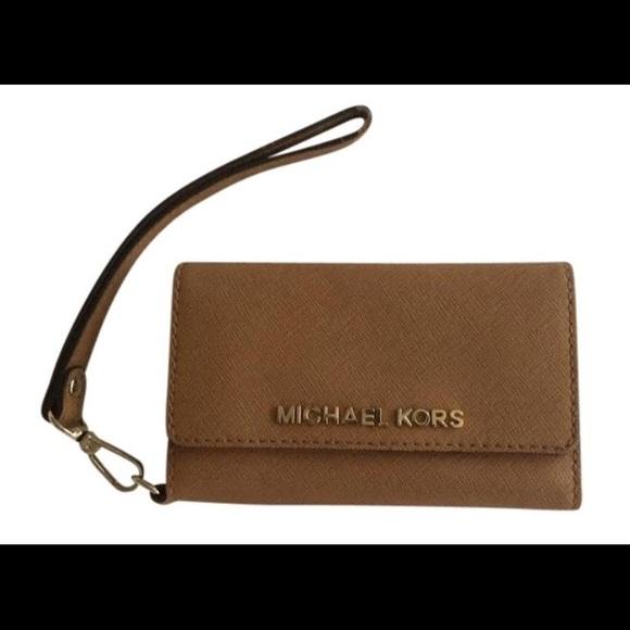 e8b5ab3fbb5b Michael Kors iPhone 5 wallet wristlet. M_57a2c69a8f0fc4374d00ad1f. Other  Accessories ...