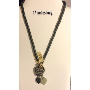 Necklace with 3 heart charms. 17 inches long