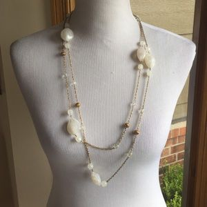 White stones on gold chain necklace
