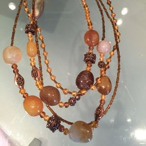 Multi strand brown gold necklace with glass beads