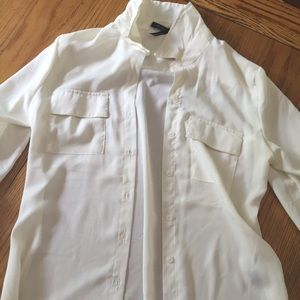 Tops - White semi sheer button down top.
