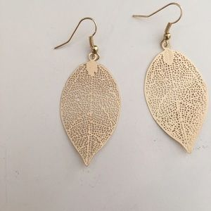 Gold tone leaf dangle earrings