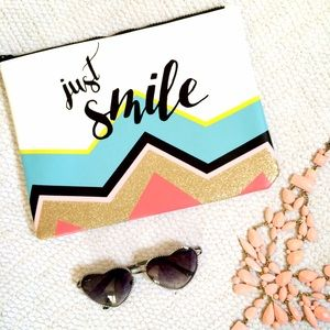 """Handbags - NWOT """"Just Smile"""" Faux Leather Clutch"""
