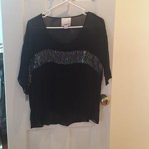 Sheer black long sleeve blouse.