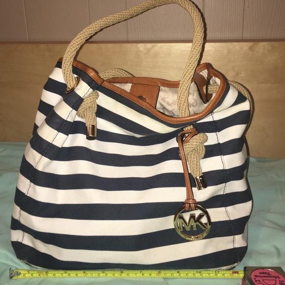 f5f648860bb220 Michael Kors navy striped cloth shoulder bag. M_57a931b38f0fc47496015620