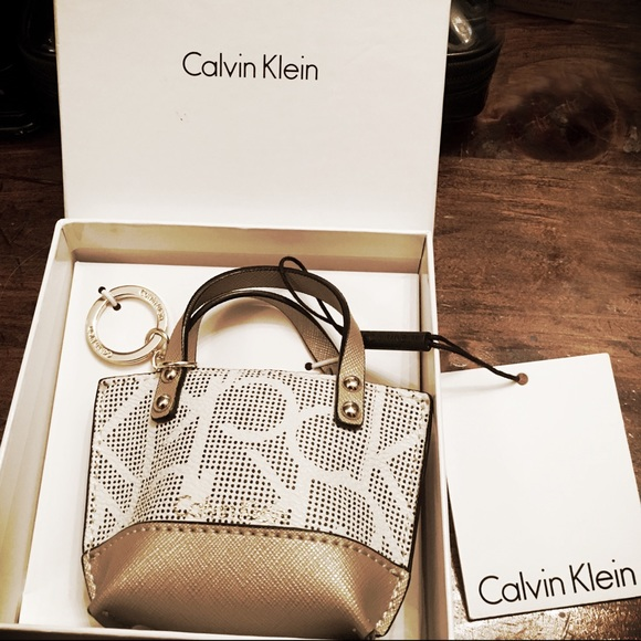 67 off calvin klein accessories calvin klein key chain with mini purse from lisa 39 s closet on. Black Bedroom Furniture Sets. Home Design Ideas