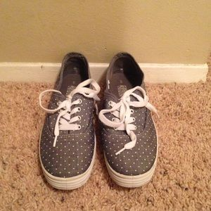 Navy and white polka dot tennis shoes