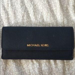 c83a6f5ff91a Michael Kors Bags - Navy Blue Michael Kors Envelope Wallet