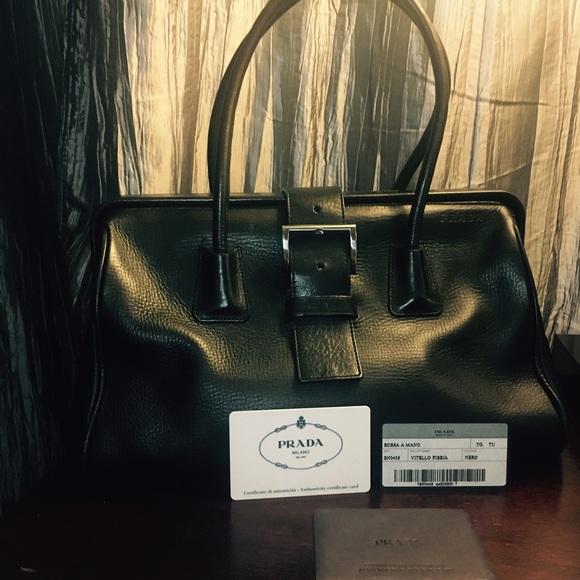 Prada black calf leather hard frame satchel. M 592afb014e95a3354e06aaf8 da8493d001ca5
