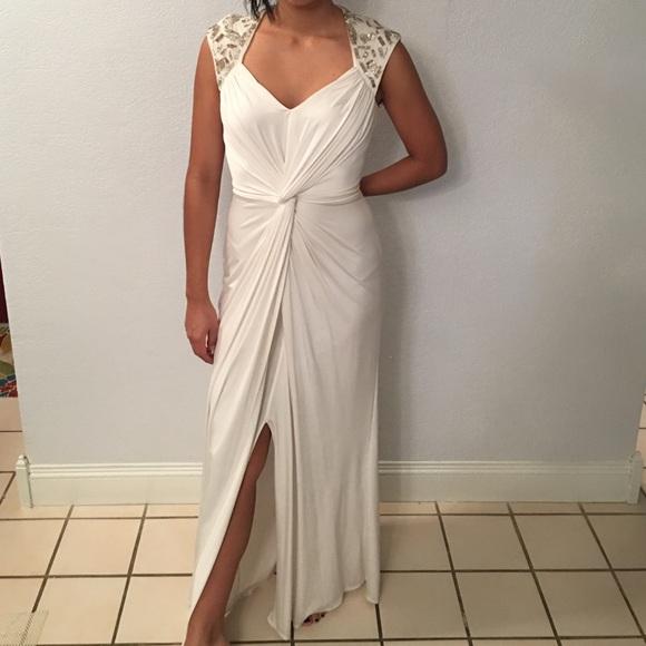 White Greek goddess inspired evening gown.
