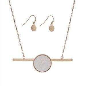 Gold necklace set w/ a 2 tone circle & bar pendant
