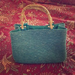 Straw satchel with bamboo handles